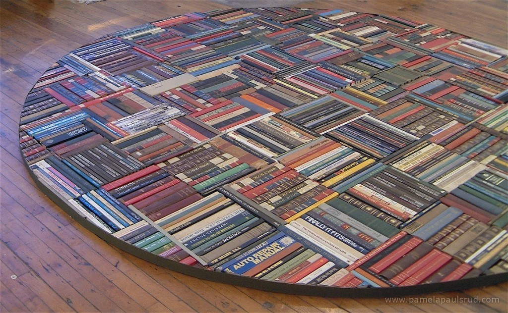 A round floor panel made from the spines of old books