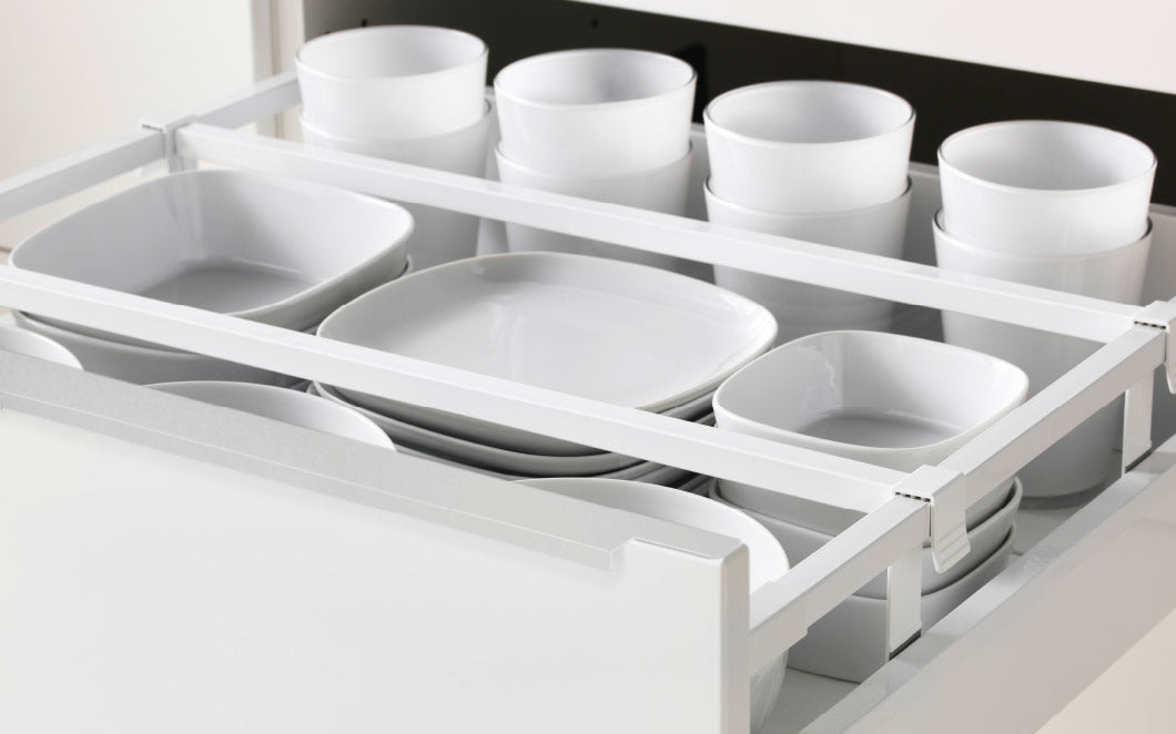 Open Drawer With White Bowls, Plates And Cups