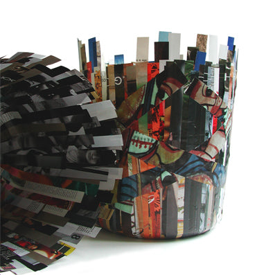 Waste paper basket made from old magazines