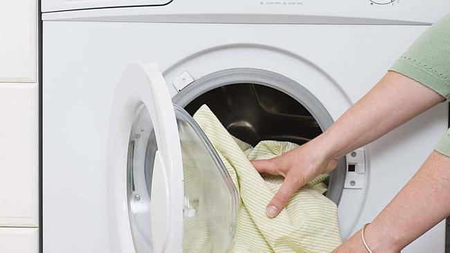 Clothes being put in a washing machine