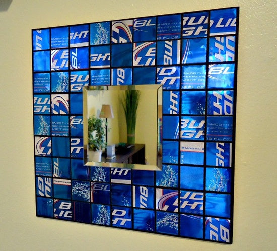 Empty Drink Cans With A Blue Logo, Cut Up Into A Square And Used To Frame A Mirror