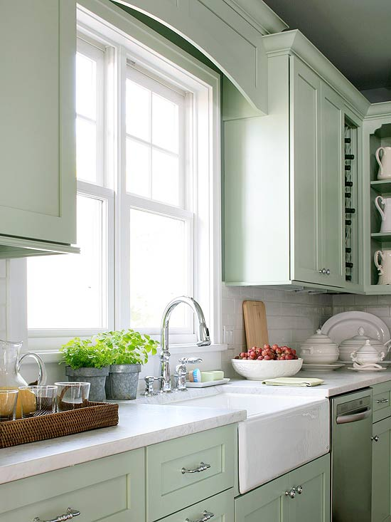 Mint green kitchen, with Belfast sink and large bright window letting in lots of light