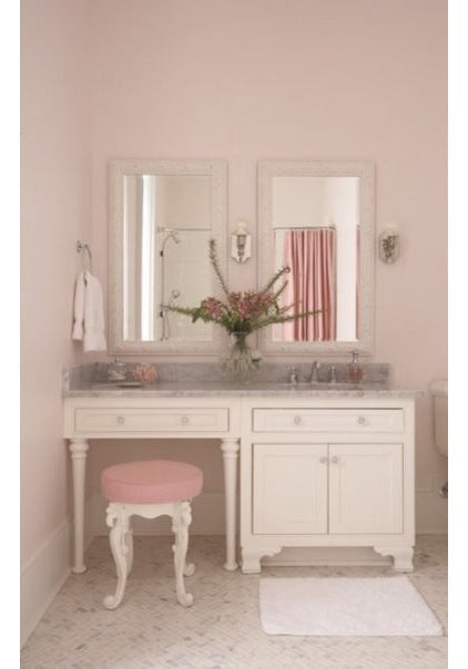 A cream bathroom dressing room, with dressing table and two mirrors