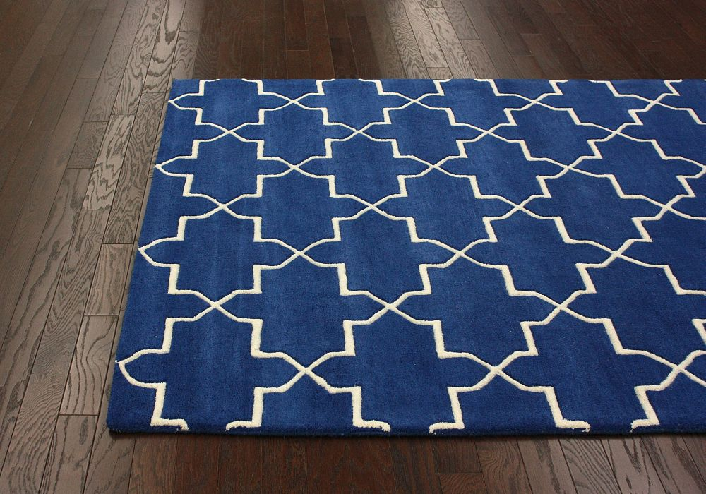 A geometric patterned rug in dark blue and white