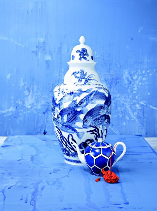 Blue room and blue table top, with a blue and white ceramic vase and small teapot
