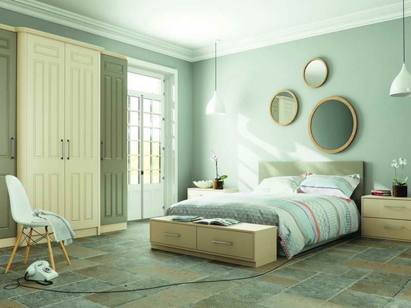 Mint green bedroom with stylish earth tone floor tiles