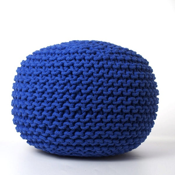 A dark blue foot pouffe
