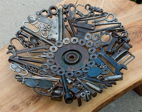 Decorative bowl made from old bolts, nuts and washers welded together