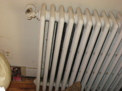 An old white metal radiator