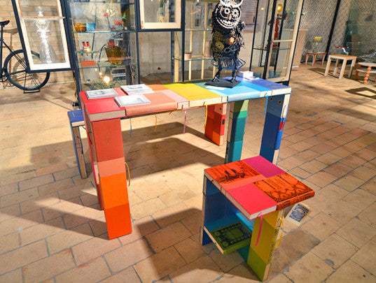 Multicoloured table made from old books