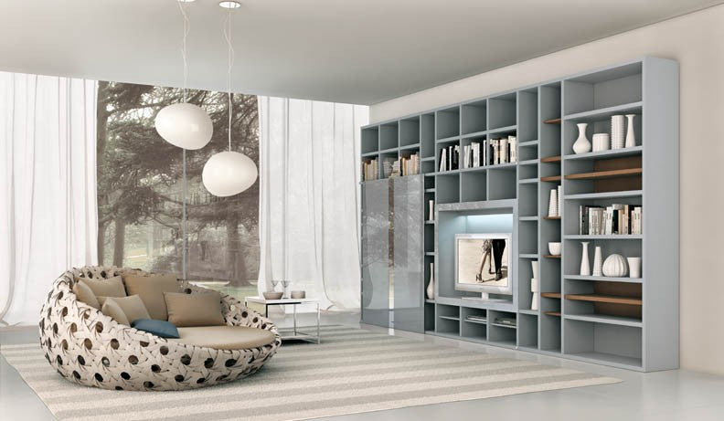 beige living room with grey shelving unit covering one wall and cosy snuggle style two seater chair
