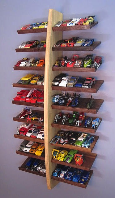 A suspended set of shelves with toy cars, planes and helicopters