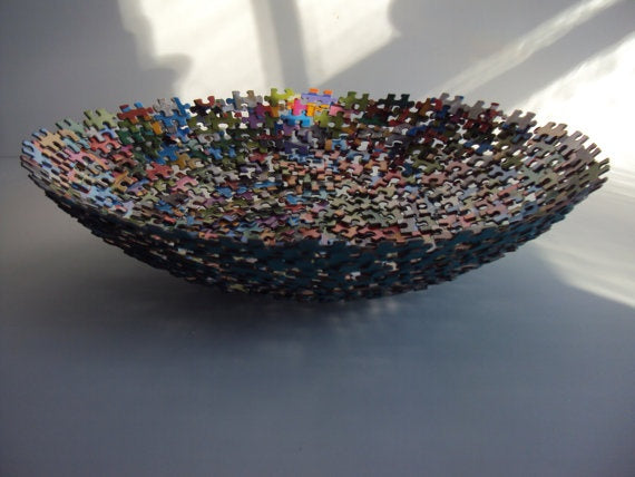 A fruit bowl made from lots of jigsaw pieces glued together