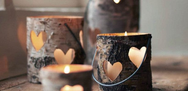Hollowed out branches cut into pieces to make candle holders