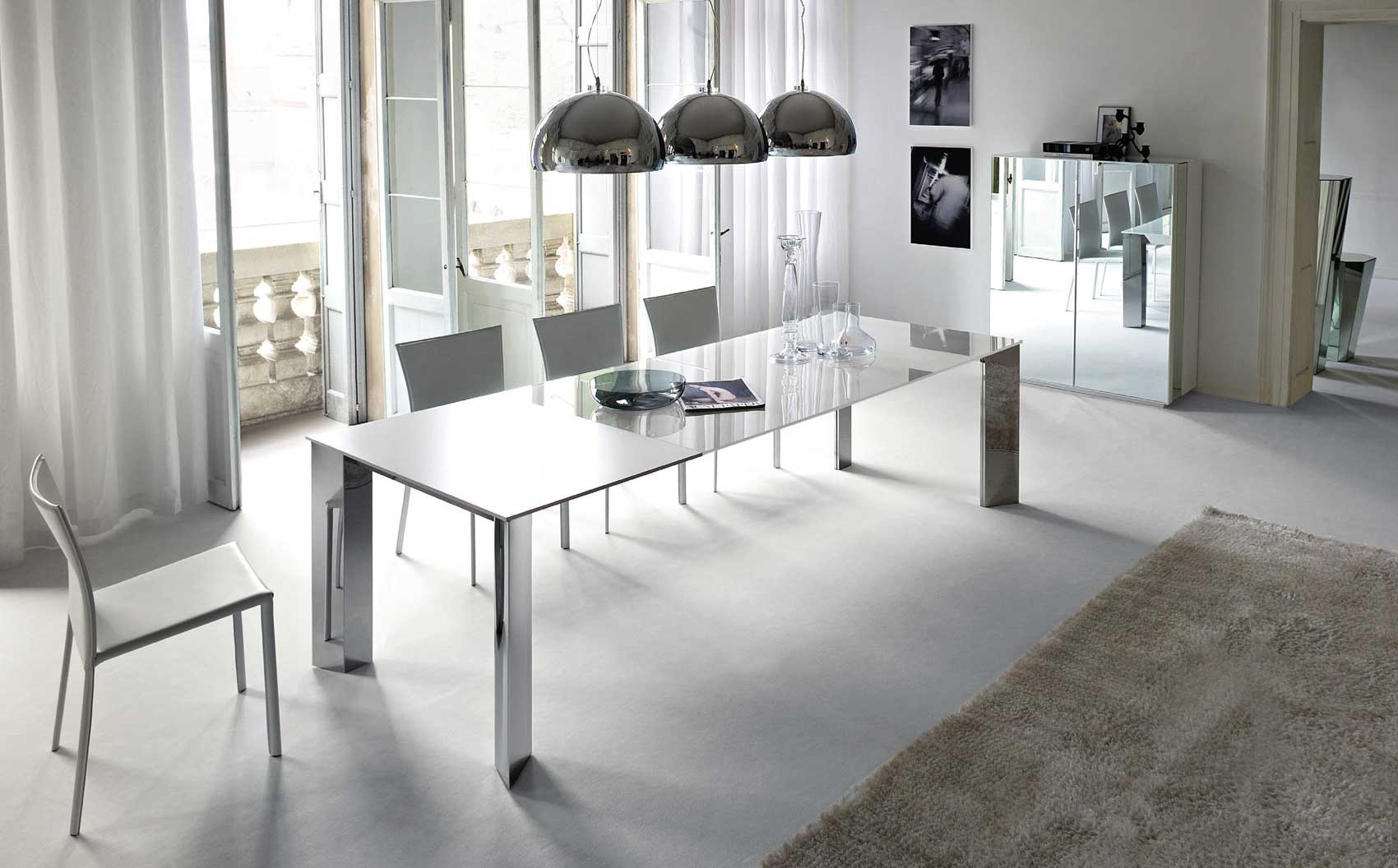 Grey dining room with mirror surface dining table and cabinets