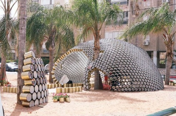 Outdoor pavilion that looks like an igloo made from recycled tin cans