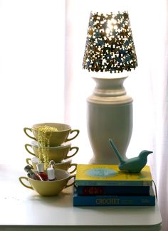 Lamp shade made from jigsaw pieces, on top of a table lamp on a table