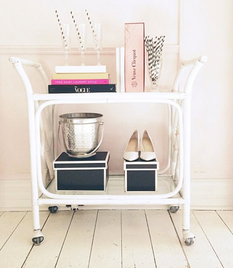 White storage trolley with shoes and books on it