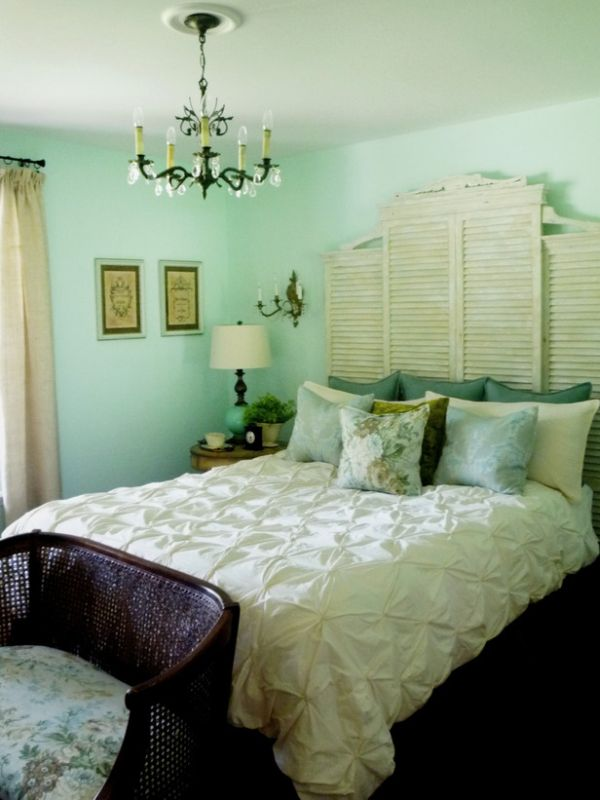 Mint green bedroom with cream bedding and cream curtains