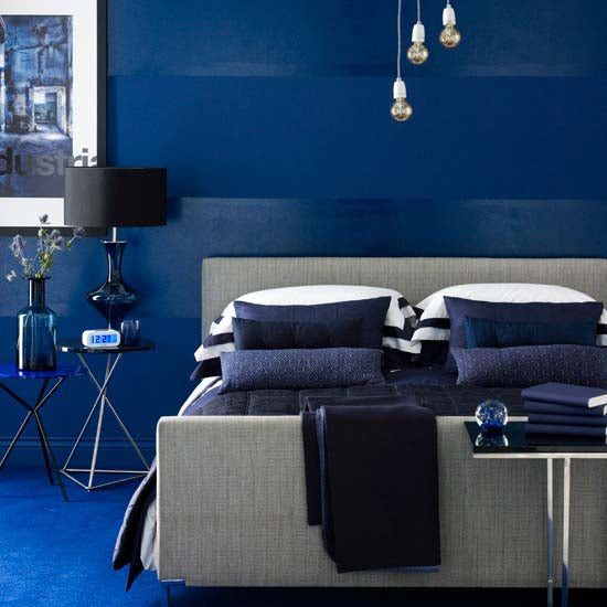 Cobalt blue and grey bedroom with matching accessories