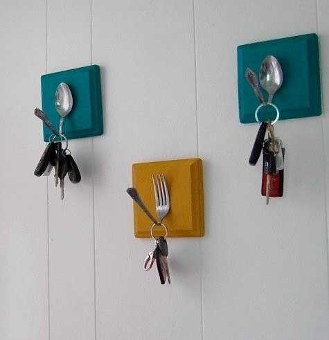 Spoons and forks attached to the wall and used to hang keys