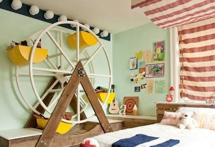 Mint green bedroom with miniature Ferris wheel with each compartment used to store toys