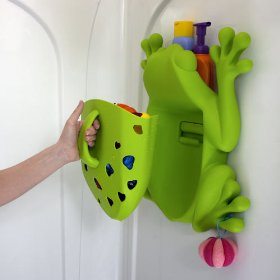 A plastic green frog attached to the wall, with detachable container for storing toys