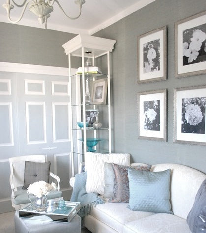 Dark grey, light grey and white living room with white sofa and light blue cushions