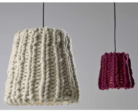 Two lampshades with knitted covers, one cream and one dark red