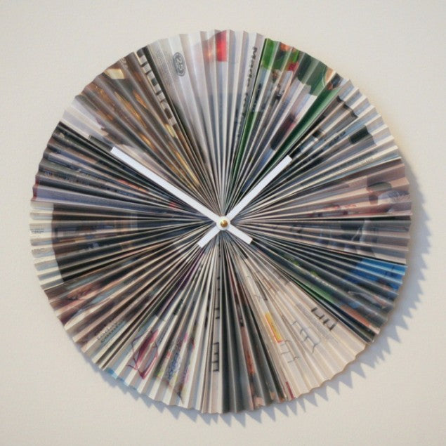 A clock made from old papers, looks like a concertina fan