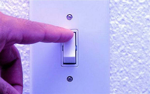 A finger flicking a light switch
