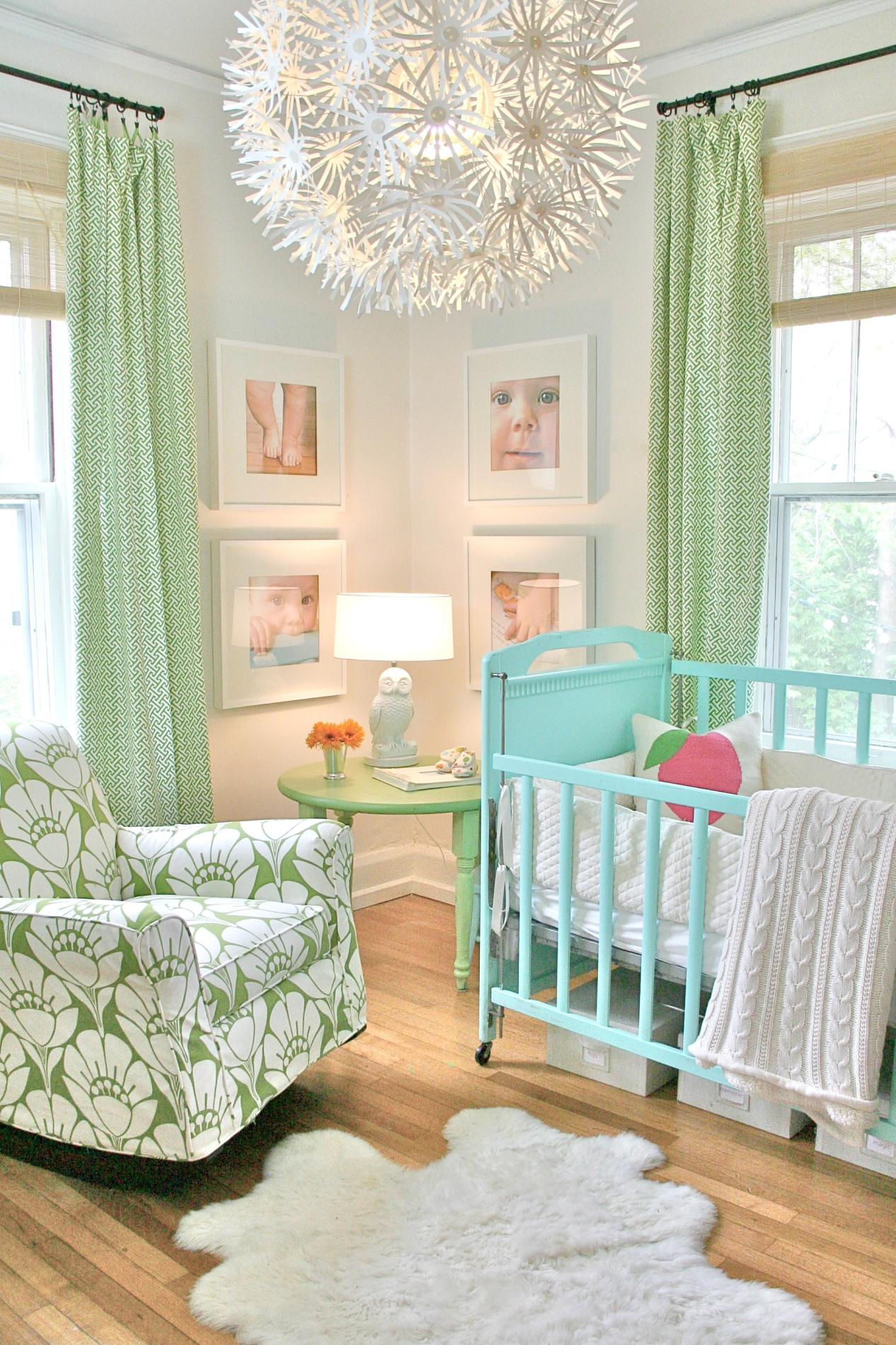 Light green curtains and floral Chintz armchair, with turquoise baby cot