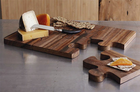 Chopping board made from six large jigsaw pieces