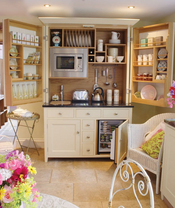 Modern cream welsh dresser with doors that open to reveal a kettle, toaster and microwave