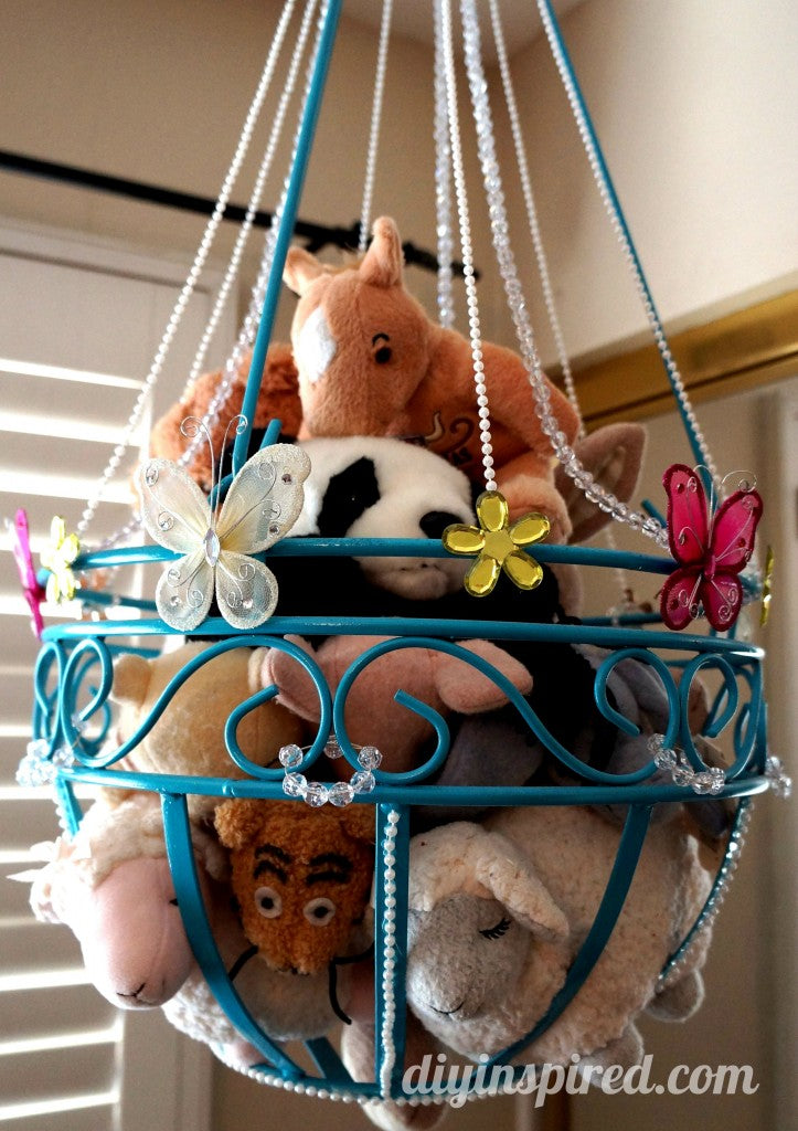 An indoor hanging basket used to store stuffed toys in