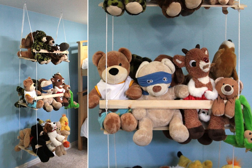 Teddies sitting on a rope shelf suspended from the ceiling