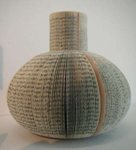 A vase made from a recycled book
