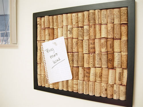 A wall mounted cork board made from win bottle corks
