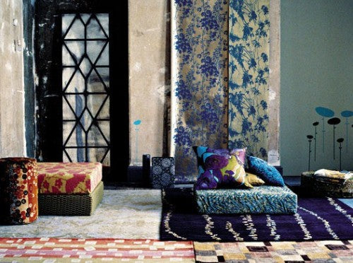 Moroccan style living room with dark blues, purple and orange