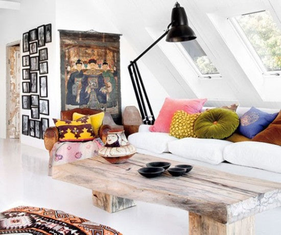 Swedish apartment with driftwood style coffee table and skylight windows