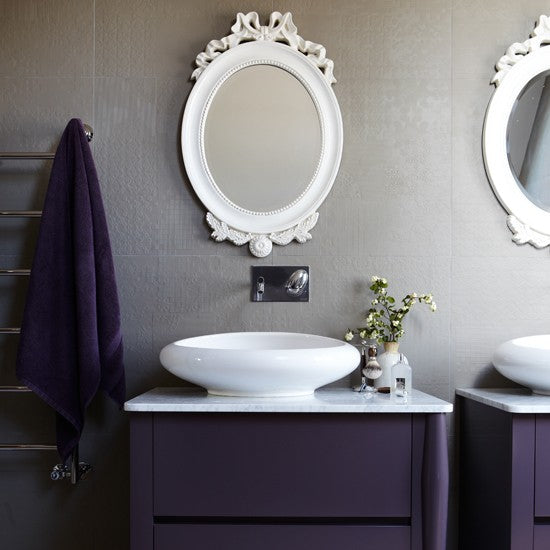 Aubergine And Grey Bathroom With White Elliptical Mirrors Above A White Sink