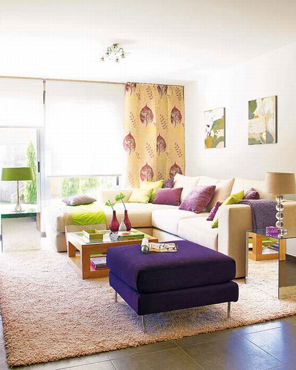 Purple Ottoman Foot Stool And Matching Purple And Green Cushions On A Cream Sofa