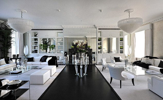 White and black luxury living space with white sofas and glass coffee tables