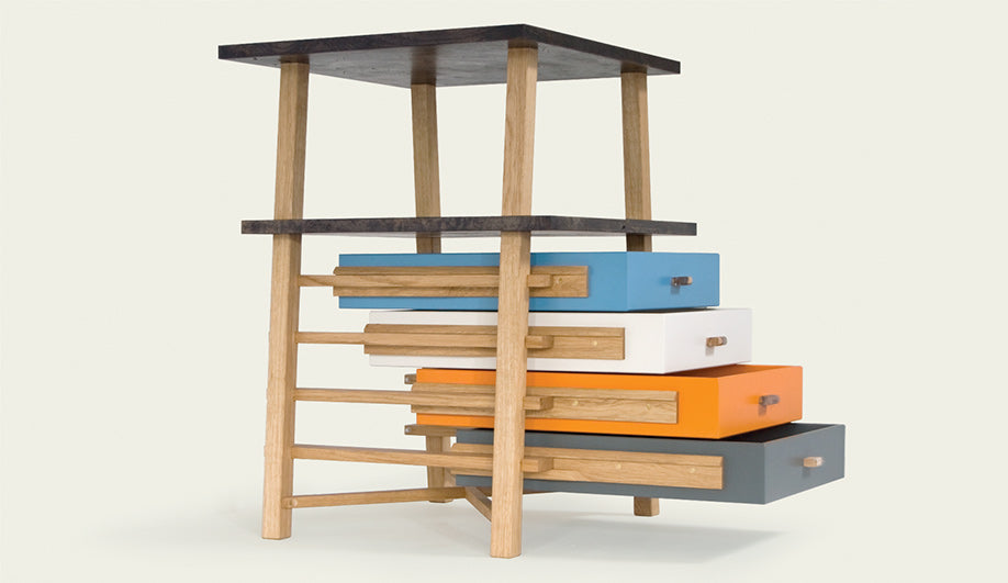 Small Stool And Multicoloured Storage Drawers
