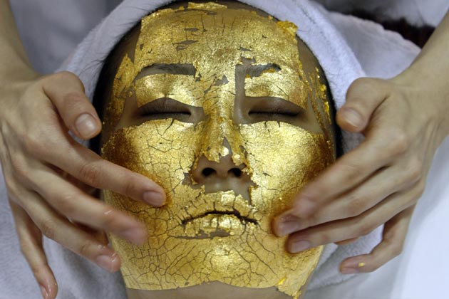 Gold leaf face mask on a woman