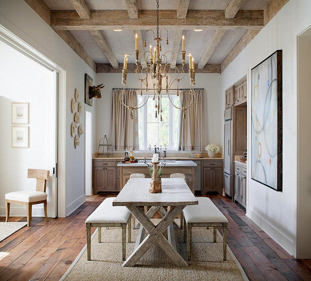 French farmhouse kitchen with white and natural wood furniture