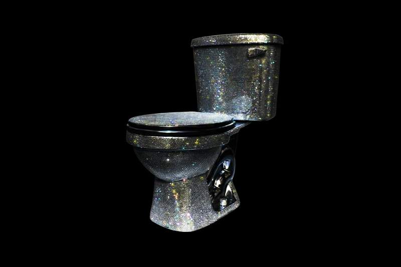 A diamond covered glittery toilet