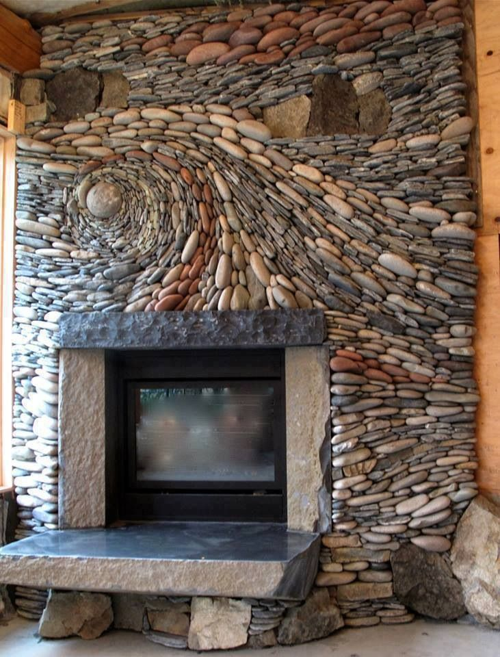 A decorative pebble fire surround that looks like a swirling river