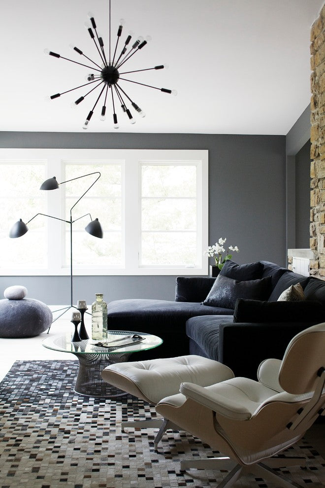 Stunning-Shades-Of-Grey-Decorating-ideas-for-fascinating-Family-Room-Contemporary-design-ideas-with-Eames-Lounge-Chair-felt-sculpture-gray-gray-walls-hide-rug-