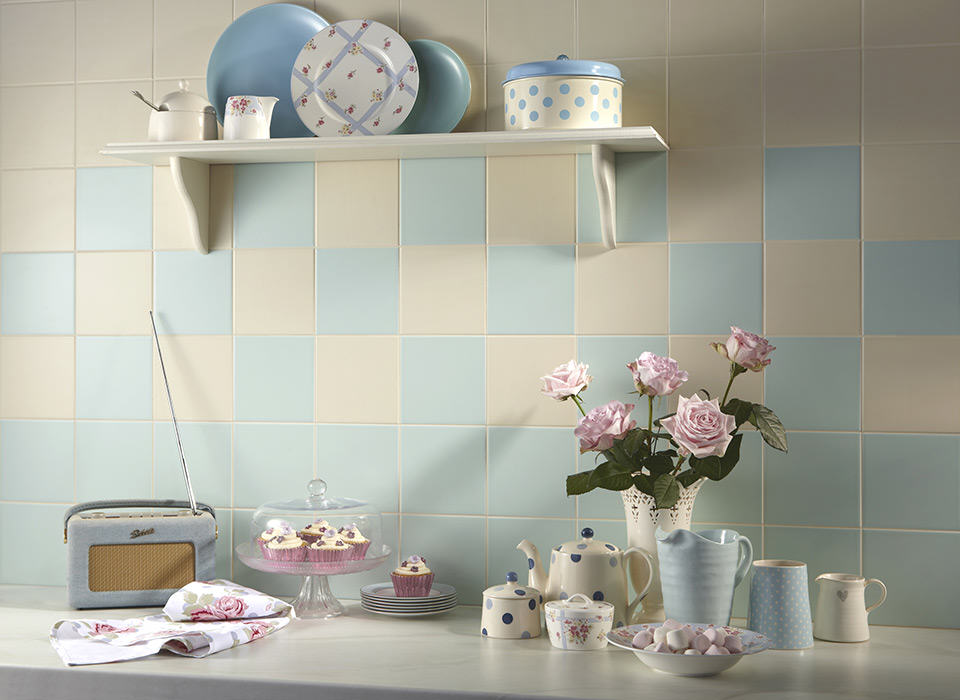 Retro Kitchen With Vintage Accessories And Light Blue And Cream Tiles